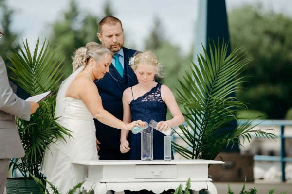 Family pouring Wedding unity glass